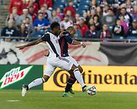 Foxborough, Massachusetts - July 29, 2017: First half action. In a Major League Soccer (MLS) match, New England Revolution (blue/white) vs Philadelphia Union (white), at Gillette Stadium.