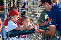 Connecticut Tigers pitcher Carson Lance (58) signs autographs for young fans before a game against the Auburn Doubledays on August 8, 2017 at Falcon Park in Auburn, New York.  Auburn defeated Connecticut 7-4.  (Mike Janes/Four Seam Images)