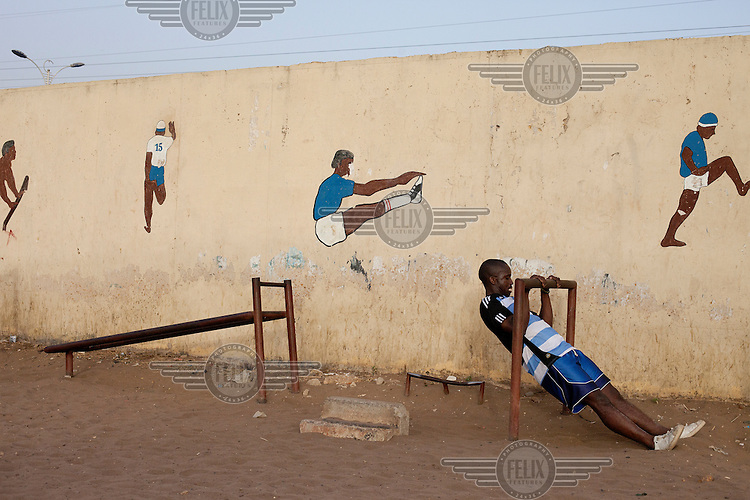 A child plays on equipment in a playground in Dakar.