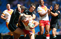 PICTURE BY VAUGHN RIDLEY/SWPIX.COM - Rugby League - Super League Magic Weekend - Catalans Dragons v London Broncos - Eithad Stadium, Manchester, England - 27/05/12 - Catalan's Clint Greenshields is tackled by London's Tony Clubb and Michael Witt.