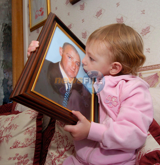 Two year old Jodie Browne holding the only memory of her father Kenny Curtis at his home in Dunboyne Co Meath..Photo NEWSFILE/FRAN CAFFREY..(Photo credit should read FRAN CAFFREY/NEWSFILE/AFP)...This Picture has been sent you under the condtions enclosed by:.Newsfile Ltd..the Studio,.Millmount Abbey,.Drogheda,.Co Meath..Ireland..Tel: +353(0)41-9871240.Fax: +353(0)41-9871260.GSM: +353(0)86-2500958.email: pictures@newsfile.ie.www.newsfile.ie.FTP: 193.120.102.198..This picture is from Fran Caffrey@newsfile.ie