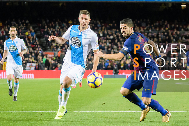 Fabian Lukas Schar of RC Deportivo La Coruna (L) in action against  Luis Suarez of FC Barcelona (R) during the La Liga 2017-18 match between FC Barcelona and Deportivo La Coruna at Camp Nou Stadium on 17 December 2017 in Barcelona, Spain. Photo by Vicens Gimenez / Power Sport Images