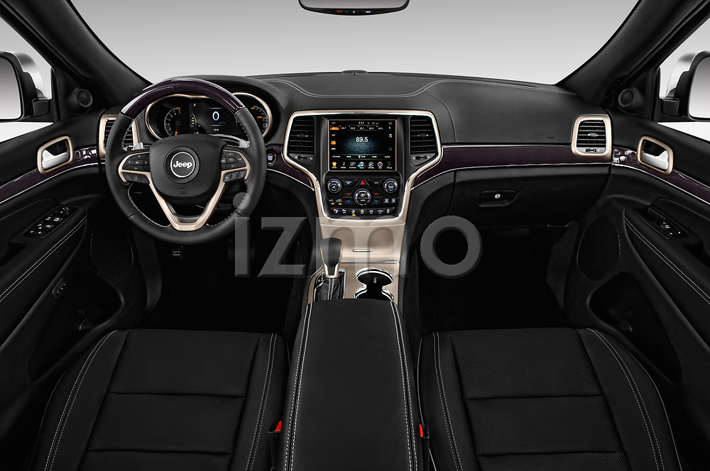 Stock photo of straight dashboard view of a 2017 Jeep Grand Cherokee Overland 5 Door SUV