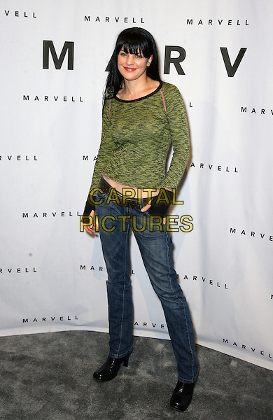 PAULEY PERRETTE.Celebrities participate in the 2010 Consumer Electronics Show (CES)at the Las Vegas Convention Center, Las Vegas, Nevada, USA, 9th January 2010..full length green top black hand warmers jeans boots .CAP/ADM/MJT.© MJT/AdMedia/Capital Pictures.