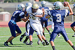 Torrance, CA 09/08/11 - Jeric Lagmay (Peninsula #65) and unidentified North players in action during the North-Peninsula Junior Varsity Football game at North High School in Torrance.