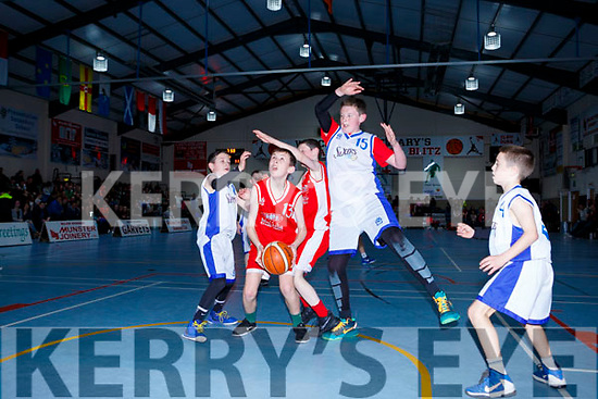 Sean Finnegan Holy Family NS 6th Rathmore tries for a basket unders pressure from Michael Toger Holy Family NS 5th Rathmore in the Senior NS A final at the St Marys Basketball Blitz on Saturday