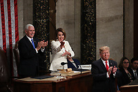 United States Vice President Mike Pence and Speaker of the United States House of Representatives Nancy Pelosi (Democrat of California) applaud as United States President Donald J. Trump finished delivering his second annual State of the Union Address to a joint session of the US Congress in the US Capitol in Washington, DC on Tuesday, February 5, 2019.<br /> CAP/MPI/RS<br /> &copy;RS/MPI/Capital Pictures