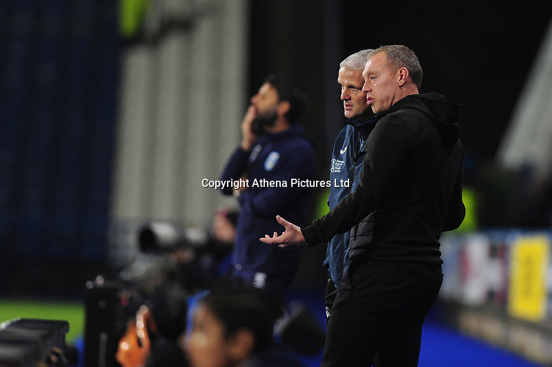 Steve Cooper Head Coach of Swansea City speaks with Mike Marsh, assistant first team coach for Swansea City during the Sky Bet Championship match between Huddersfield Town and Swansea City at The John Smith's Stadium in Huddersfield, England, UK. Tuesday 26 November 2019