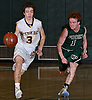 Elia DeBlasio #3 of Oyster Bay, left, dribbles downcourt as Nate Armstrong #1 of Carle Place defends during the Nassau County varsity boys basketball Class B final at SUNY Old Westbury on Thursday, Feb. 23, 2017. Oyster Bay won by a score of 51-31.