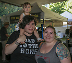 Chad, Margaret and 15-month old Remi Flores during the Feed the Camel food truck night at the McKinley Arts Center in Reno on Wednesday, June 28, 2017.