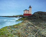 Bandon, Oregon   <br /> Coquille River Lighthouse under stormy skies.