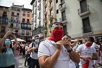 PAMPLONA, SPAIN - July 06: People dressing  white clothes, red scarves, and masks take to the streets of the Old Town where the ''txupinazo'' would usually take place to start the famous San Fermin festival, which was canceled this year by the conoravirus. In Pamplona, July 06, 2020 (Photo by Maite H. Mateo /VIEWpress via Getty Images)
