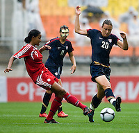 USWNT forward (20) Abby Wambach blocks the pass of Canada's (9) Candace Chapman during the finals of the Peace Queen Cup.  The USWNT defeated Canada, 1-0, at Suwon World Cup Stadium in Suwon, South Korea.