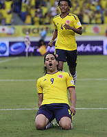 BARRANQUILLA - COLOMBIA - 11 -06 -2013:Radamel Falcao  García celebra un gol en contra de Perú en partido por la clasificación al mundial de fútbol Brasil 2014 realizado en el estadio Metropolitano de la ciudad de Barranquilla./ Radamel Falcao  Garcia celebrates a goal against Peru during match for the qualification to the World Cup Brazil 2014 at Metropolitano stadium in Barranquilla. VizzorImage / Felipe Caicedo / Staff