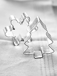 Snowflake and Christmas tree cookie cutters. Black and white image