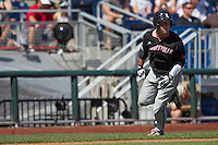 Louisville catcher Kyle Gibson (14) rounds third base headed home against the Oregon State Beavers during Game 5 of the 2013 Men's College World Series on June 17, 2013 at TD Ameritrade Park in Omaha, Nebraska. The Beavers defeated Cardinals 11-4, eliminating Louisville from the tournament. (Andrew Woolley/Four Seam Images)