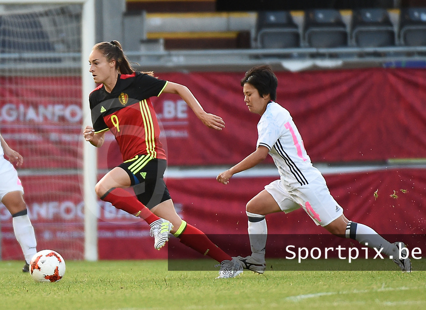 20170613 - LEUVEN ,  BELGIUM : Belgian Tessa Wullaert (L) and Japanese Yu Nkasato (R) pictured during the female soccer game between the Belgian Red Flames and Japan , a friendly game before the European Championship in The Netherlands 2017  , Tuesday 13 th Juin 2017 at Stadion Den Dreef  in Leuven , Belgium. PHOTO SPORTPIX.BE | DIRK VUYLSTEKE