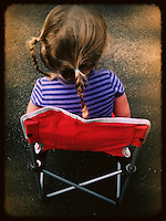 Girl sitting in chair from back. iPhone photo with app