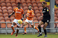 Blackpool's Armand Gnanduillet under pressure from Barnsley's Ethan Pinnock <br /> <br /> Photographer Rich Linley/CameraSport<br /> <br /> The EFL Sky Bet League One - Blackpool v Barnsley - Saturday 22nd December 2018 - Bloomfield Road - Blackpool<br /> <br /> World Copyright &copy; 2018 CameraSport. All rights reserved. 43 Linden Ave. Countesthorpe. Leicester. England. LE8 5PG - Tel: +44 (0) 116 277 4147 - admin@camerasport.com - www.camerasport.com