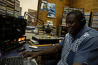 Alberto Dabbo, local journalist, threatened  by his own government for having spoke publicly about the implications of the national government and the military  in the cocaine trafficking, conducts his own radio show at Radio Bombolom in Bissau, Guinea Bissau on Monday Sept 17 2007..///..Guinea Bissau is infamous for its cocaine trafficking. in 2005 Colombian cartels begun to arrive in the country transforming it into a Narco State. Up to 5 tons of pure cocaine are estimated to be arriving in the country every week. Guinea Bissau is the 5th poorest country in the world, making it the ideal transit base for the cocaine that will finish on the european markets. Corruption and involvement in the trafficking are present at every level of its institutions..Guinea Bissau is only one of the countries in West Africa involved in cocaine trafficking. Tons of Cocaine have been seized in Nigeria, Senegal, Ghana and  Sierra Leone.