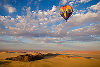 Hot air balloons in the sky over Namibia.