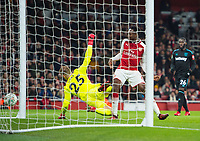 Arsenal's Danny Welbeck scoring first goal during the Carabao Cup QF match between Arsenal and West Ham United at the Emirates Stadium, London, England on 19 December 2017. Photo by Andrew Aleksiejczuk / PRiME Media Images.