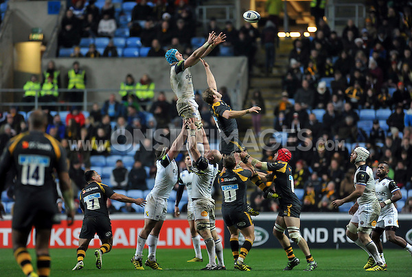 David Denton of Bath Rugby rises high to win lineout ball. European Rugby Champions Cup match, between Wasps and Bath Rugby on December 13, 2015 at the Ricoh Arena in Coventry, England. Photo by: Patrick Khachfe / Onside Images