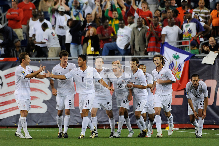 Stuart Holden (10) of the United States (USA) celebrates scoring the game tying goal with teammates. The United States and Haiti played to a 2-2 tie during a CONCACAF Gold Cup Group B group stage match at Gillette Stadium in Foxborough, MA, on July 11, 2009. .