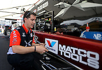 Apr. 5, 2013; Las Vegas, NV, USA: (Editors note: Special effects lens used in creation of this image) NHRA top fuel dragster driver Spencer Massey in the pits during qualifying for the Summitracing.com Nationals at the Strip at Las Vegas Motor Speedway. Mandatory Credit: Mark J. Rebilas-