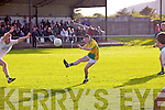 South Kerry's Eoin O'Mahony is too slow to the ball as Mitcheal's Sean Maloney is given too much space as he slots this one over the bar.
