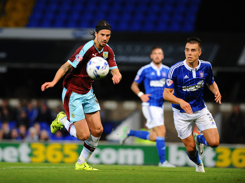 Burnley's George Boyd (L) keeps a close eye on the ball<br /> <br /> Photographer Ashley Pickering/CameraSport<br /> <br /> Football - The Football League Sky Bet Championship - Ipswich Town v Burnley - Tuesday 18th August 2015 - Portman Road - Ipswich<br /> <br /> &copy; CameraSport - 43 Linden Ave. Countesthorpe. Leicester. England. LE8 5PG - Tel: +44 (0) 116 277 4147 - admin@camerasport.com - www.camerasport.com