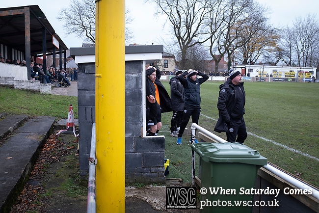 Atherton Collieries 1, Boston United 0, 23/11/19. Alder House, FA Trophy, third qualifying round. Home manager Michael Clegg (right) and his staff react to a missed chance during the first-half as Atherton Collieries played Boston United in the FA Trophy third qualifying round at the Skuna Stadium. The home club were formed in 1916 and having secured three promotions in five season played in the Northern Premier League premier division. This was the furthest they had progressed in the FA Trophy and defeated their rivals from the National League North by 1-0, Mike Brewster scoring a late winner watched by a crowd of 303 spectators. Photo by Colin McPherson.
