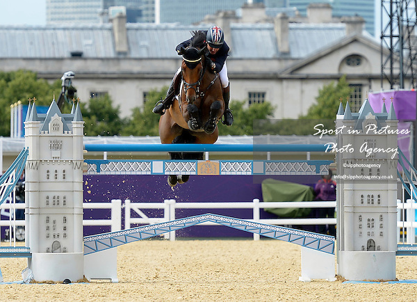 Peter Charles riding Vindicat (GBR, Great Britain) clears the last fence to give team GB the victory. Team Showjumping - PHOTO: Mandatory by-line: Garry Bowden/SIP/Pinnacle - Photo Agency UK Tel: +44(0)1363 881025 - Mobile:0797 1270 681 - VAT Reg No: 768 6958 48 - 06/08/2012 - 2012 Olympics - Greenwich Park, London, England