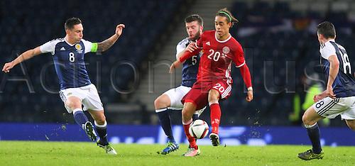 29.03.2016. Hampden Park, Glasgow, Scotland. International Football Friendly Scotland versus Denmark.  Scott Brown, Grant Hanley and Yussuf Yurary Poulsen battle for the ball