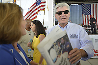 Gulfport, MS 8/28/15 Mississippi Governor Phil Bryant checks the morning papers as he waits for  the 10th Anniversary Hurricane Katrina event. to begin. President George Bush joined Mississippi Governor's Haley Barbour and Governor Phil Bryant  for a first responders event to commemorate the 10th Anniversary of Hurricane Katrina in Gulfport Mississippi. Photo ©Suzi Altman