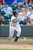 Michael Marjama (8) of the Winston-Salem Dash attempts to lay down a bunt against the Carolina Mudcats at BB&T Ballpark on June 6, 2014 in Winston-Salem, North Carolina.  The Mudcats defeated the Dash 3-1.  (Brian Westerholt/Four Seam Images)