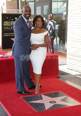 HOLLYWOOD, CA - JULY 11: Niecy Nash and Jay Tucker at the ceremony honoring Niece Nash at the Hollywood Walk Of Fame in Hollywood, California on July 11, 2018. Credit: Faye Sadou/MediaPunch