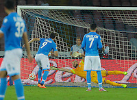 Gonzalo Higuain  shots to scores a penalty   during the Europa League   soccer match between SSC Napoli and Sparta Praha  at  the San Paolo   stadium in Naples  Italy , september 18 , 2014