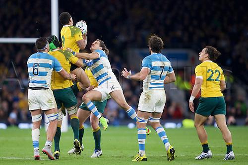 25.10.2015. Twickenham Stadium, London, England. Rugby World Cup Semi Final. Argentina versus Australia. Argentina fullback JoaquÌn Tuculet tackles Australia scrum-half Will Genia.