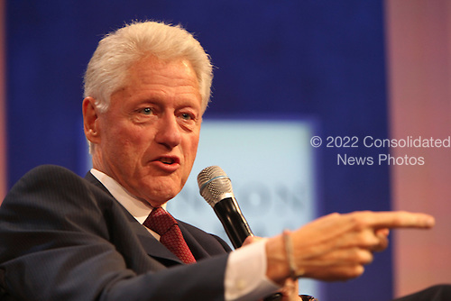 Former United States President Bill Clinton makes remarks during a conversation with U.S. President Barack Obama (not pictured) about health care at the Clinton Global Initiative for  in New York, New York on Tuesday, September 24, 2013.<br /> Credit: Allan Tannenbaum / Pool via CNP