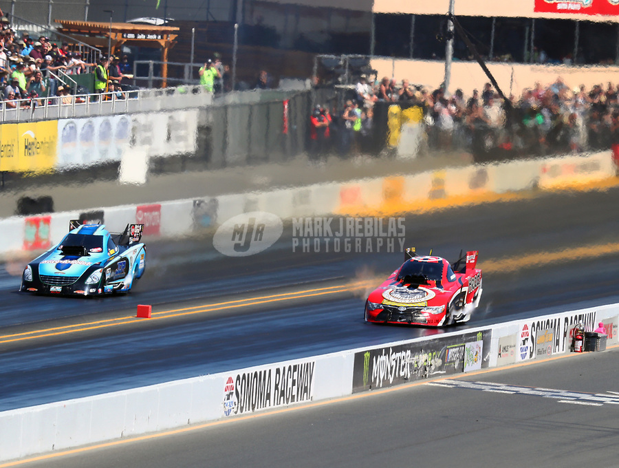 Jul 29, 2017; Sonoma, CA, USA; NHRA funny car driver Jonnie Lindberg (right) races alongside Jeff Diehl during qualifying for the Sonoma Nationals at Sonoma Raceway. Mandatory Credit: Mark J. Rebilas-USA TODAY Sports