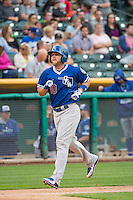 Brian Ward (10) of the Oklahoma City Dodgers  rounds the bases after hitting a home run against the Salt Lake Bees in Pacific Coast League action at Smith's Ballpark on May 25, 2015 in Salt Lake City, Utah.  (Stephen Smith/Four Seam Images)