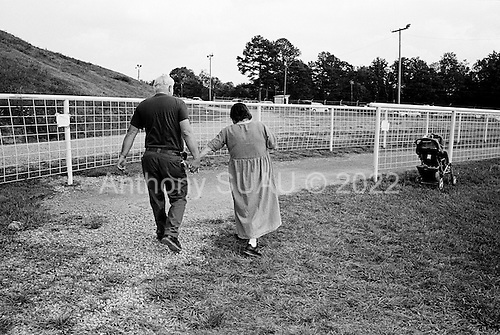 Wise, Virginia<br /> USA<br /> July 24, 2009<br /> <br /> An elderly couple leave the Remote Area Medical (RAM) health clinic at the Wise County Fairgrounds. The free clinic, which lasts 2-1/2 days, is the largest of its kind in the nation, providing medical, dental and vision services from more than 1,700 medical volunteers that treated nearly 4,000 patients. For many residents of this Appalachian area the RAM clinic serves as the only medical care they may receive each year.