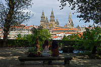 Young tourists in Alameda Park view Roman Catholic cathedral, Catedral de Santiago de Compostela, cityscape, Galicia, Spain