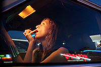 Los Angeles-based singer-songwriter Cameron Mesirow applies lipstick while sitting inside of her 1985 Mercedes in the Koreatown section of Los Angeles, California, June 16, 2009. Mesirow created the musical project Glasser and has just released her first demo available only on vinal  or through iTunes.