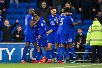 Junior Hoilett of Cardiff City (second left) is congratulated by Sol Bamba after scoring his side's second goal during the Sky Bet Championship match between Cardiff City and Norwich City at the Cardiff City Stadium, Cardiff, Wales on 1 December 2017. Photo by Mark  Hawkins / PRiME Media Images.