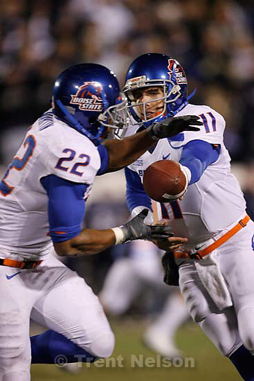 Boise State quarterback Kellen Moore hands off to Doug Martin. Utah State vs. Boise State college football Friday, November 20 2009.