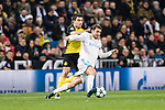 Mateo Kovacic of Real Madrid (R) in action against Borussia Dortmund Defender Sokratis Papastathopoulos (L) during the Europe Champions League 2017-18 match between Real Madrid and Borussia Dortmund at Santiago Bernabeu Stadium on 06 December 2017 in Madrid Spain. Photo by Diego Gonzalez / Power Sport Images