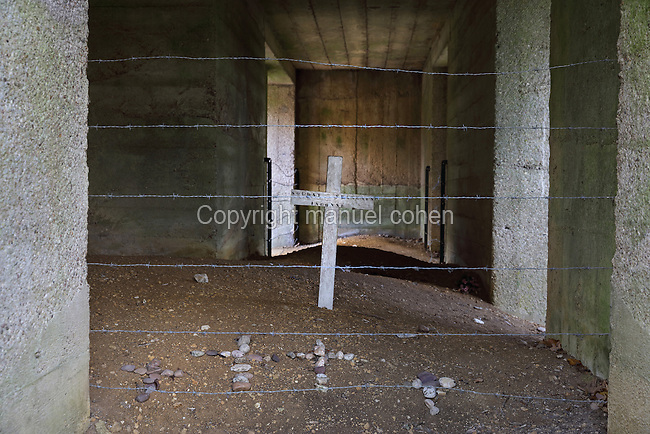 Inside the monument at the Tranchee des Baionnettes, or Trench of Bayonets, built 1919 with funds from an American, Mr Rand, and inaugurated 1920, commemorating the soldiers of the 137th infantry regiment, who were buried alive here under German bombardment in the 1916 Battle of Verdun in World War One, near Fort Douaumont, Verdun, Meuse, Lorraine, France. The trench has been covered over and crosses mark the positions of the soldiers. The monument symbolises the sacrifice of all soldiers with no grave and was the first to be built on the battlefield. Picture by Manuel Cohen