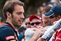 March 15, 2014: Jean-Eric Vergne (FRA) from the Scuderia Toro Rosso team signs autographs prior to practice session three at the 2014 Australian Formula One Grand Prix at Albert Park, Melbourne, Australia. Photo Sydney Low.